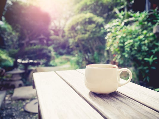 Coffee cup on table Outdoor in garden with Sunrise