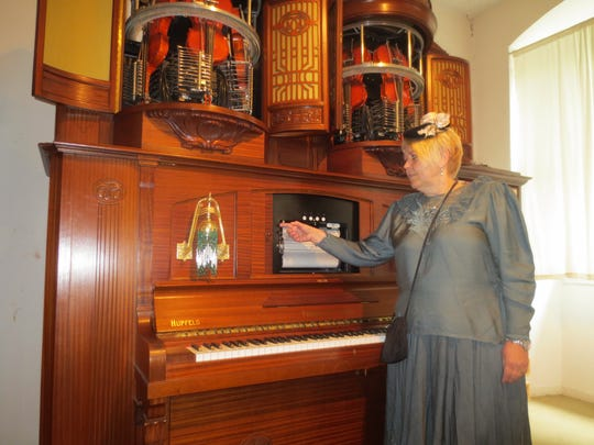 A guide turns on the  Phonoliszt-Violina, the most popular attraction at Siegfried's Mechanical Music Cabinet in Rudesheim, Germany.