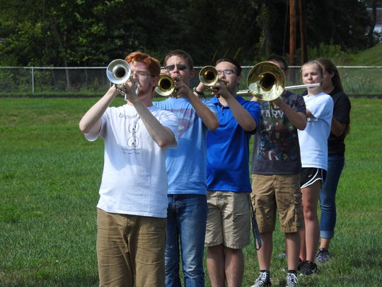 Trumpet players Jacob Heading and Bladen Johnson, from front left, will perform a trumpet duet during halftime at Friday's football game between Coshocton and Fairless high schools at Stewart Field. Also pictured rehearsing here are trumpeter Tyler Huston, mellophonist Brandon Logan, and flutists Jenna Stonebraker and Sherridan Erman.