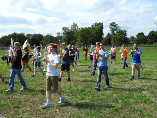 Members of the Coshocton High School Marching Band practice their steps while preparing for the first football game of the season, which is set to begin at 7 p.m. Friday in the newly revamped Stewart Field.