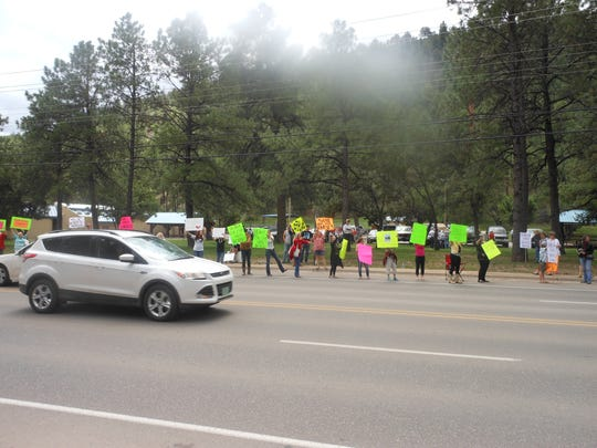 Protesters lined the street Sunday in front of Schoolhouse