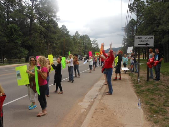 Horns were honking and protesters shouted Sunday voicing