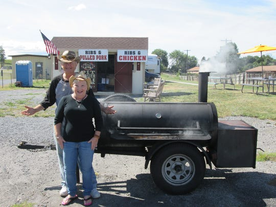 Ted and Margaret Chuparkoff pose with their smoker outside of their roadside BBQ business, Western Redneck BBQ, 2010 Lincoln Way West.