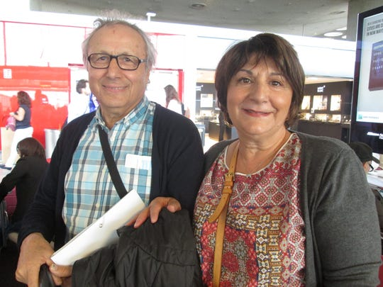 At the airport in Paris on their way to immigrate to