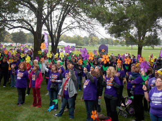 A Promise Garden was arranged during the Walk to End Alzheimer's on Oct. 1 at Moraine Park Technical College. Each participant received a colored flower that designates how Alzheimer's disease has impacted them or their family. Blue flowers are given to those individuals living with the disease; purple flowers are given to those who have lost someone to the disease; yellow flowers are given to caregivers; and orange flowers represent individuals who are advocating for a world without Alzheimer's.