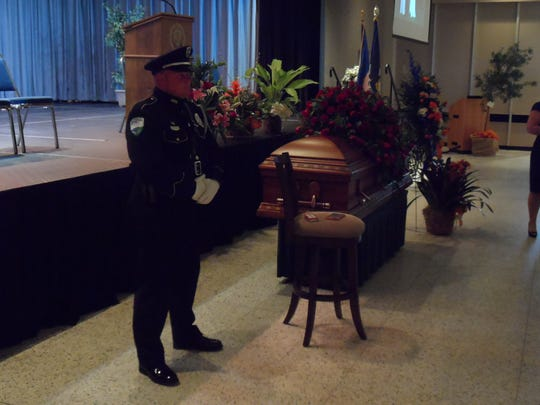 Alexandria Police Officer William Bordelon, one of the members of an honor guard, stands near the casket of former Alexandria  Mayor Ned Randolph, who was lying in repose in Convention Hall on Thursday.