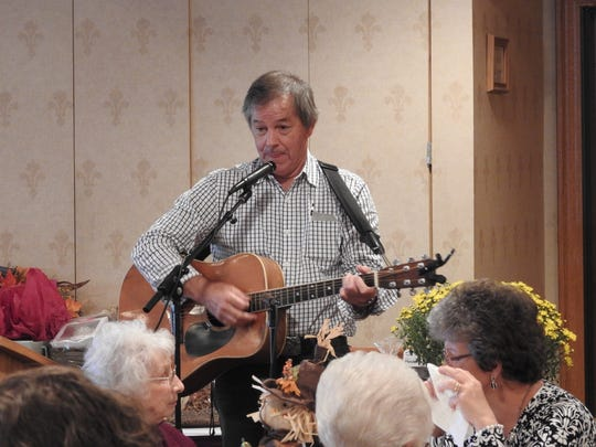 Folk and gospel singer John Schmid, of Holmes County, entertained the crowd Friday with songs on parenting, grandparenting and living in the modern world.