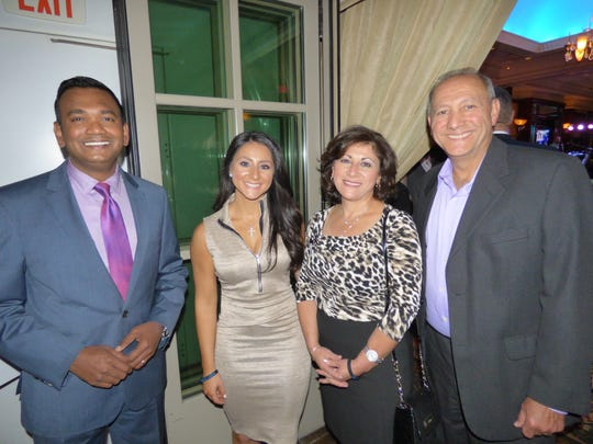 Event Emcee Roop Raj of Fox2, and Michelle, Linda and