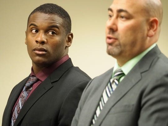 Defendant former Rutgers  football player Jamil Pollard, standing next to his attorney Raymond Santiago, appears before Superior Court Judge Dennis Nieves in New Brunswick on Friday for a status conference.  October 21,  2016  (Pool Photo: Patti Sapone | NJ Advance Media for NJ.com)