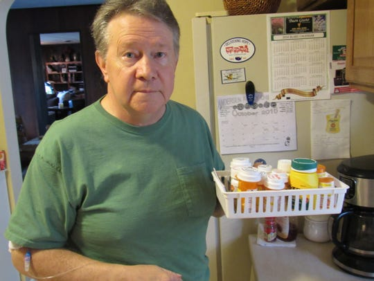Dwight Blake, 67, posing in his Delta home on Thursday,