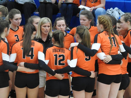 Ridgewood coach Brenda McCoy gives her team final instructions before the game against Buckeye Trail.