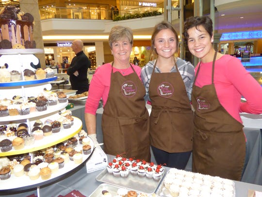 Bloomfield Hills' Yummy Cupcakes Owner Lori Horton and Delaney Horton and Baker Bethany Bonenfant of Livonia.