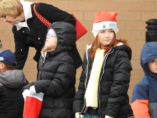 Ruby Kimball, 8, and Annabella Galliher, 9, anxiously awaited the arrival of Santa Saturday at the 14th annual Christmas Parade at Colony Square Mall.