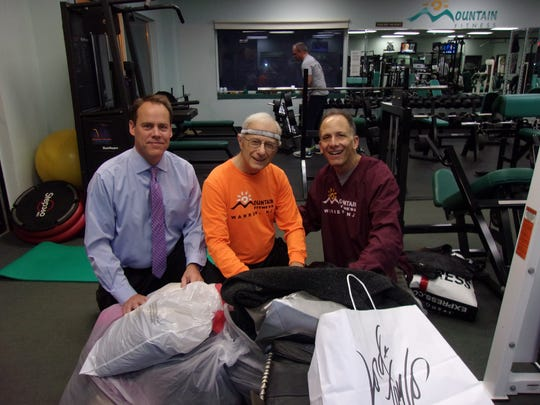 Kevin Lawlor of Green Brook, (L) coordinator of the annual St. Ann's Soup Kitchen Coat Drive, poses with (C) volunteer Don Speeney of Watchung and Ed Halper of Basking Ridge, proprietor of Mountain Fitness in Warren.  Mountain Fitness served as a drop-off point for the collection, which is sponsored by St. Mary's Church of Watchung.