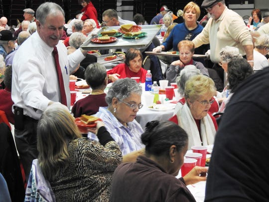 Muskingum County Commissioner Jim Porter served pumpkin pie at the Fraternal Order of Police Zane Lodge 5 annual Christmas dinner Thursday. About 500 seniors were in attendance.