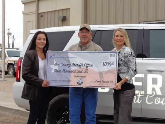 The Texas Department of Transportation recently awarded the Kent County Sheriff�s Department with a $3,000 grant for participating in the agency�s Click It or Ticket Summer Incentive, which encourages seatbelt use. From left: Katie Alexander, Law Enforcement Liaison with Texas Municipal Police Association; Kent County Sheriff William Scogin; and Jill Collett, TxDOT Abilene Traffic Safety Specialist.