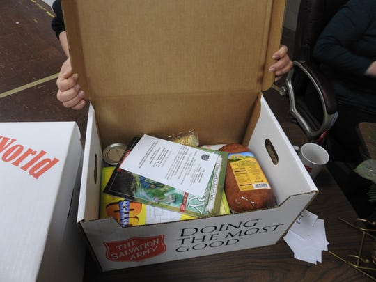 Holiday food boxes distributed through the Salvation Army Wednesday included a Christmas ham, vegetables, fruit and more for 342 Coshocton County families.