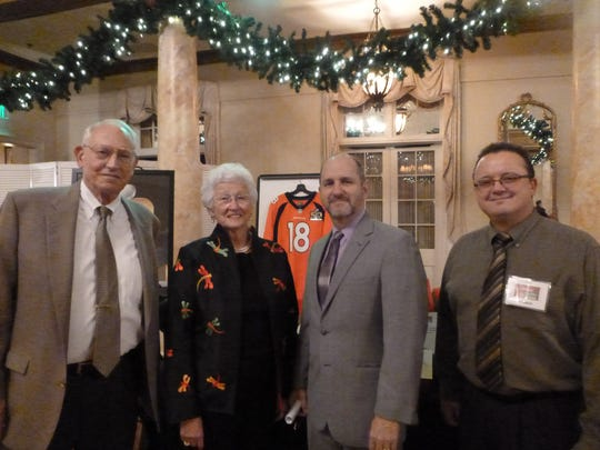 Fred and Susan Brackney (Holiday Sparkles & Spirits event chair) with JoMS executive director Francis Graffeo and the school's manager of volunteer resources, Ed Sublett, at their recent Holiday Sparkles & Spirits.