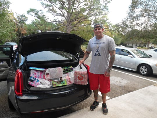 John Garappolo, owner of Inzane Tattoo of Port St. Lucie, delivers a car full of toys for Hibiscus Children's Center youth and also delivered 11 bicycles!