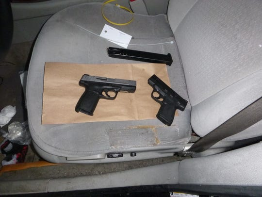 Indianapolis police seized cocaine, pills and handguns