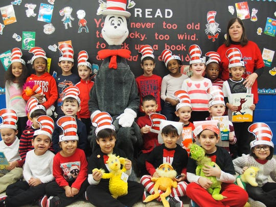 Linden School No. 1 kindergarten teacher Karen Mulligan and her students showed the Cat in the Hat their bulletin board. The students held various characters from the many Dr. Seuss books that were read in class.