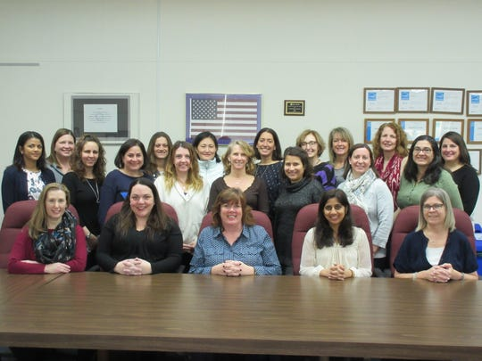 Attending the February meeting are: (seated l-r): PTC