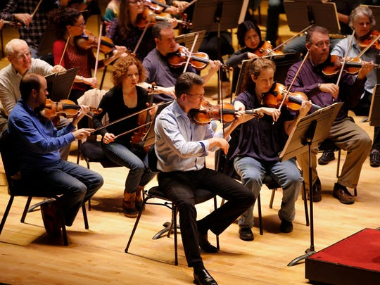 Concertmaster Timothy Lees, center, is back in his first chair of the Cincinnati Symphony Orchestra at the Taft Theatre. The violinist is making his return to the group following surgery.