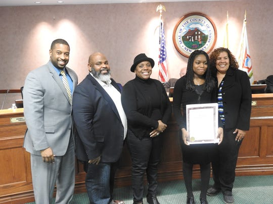 "Union County Freeholders Linda Carter (far right) and Mohamed S. Jalloh (far left) present a resolution to singer/songwriter Alexis Morrast (holding resolution) of Plainfield congratulating her on winning first prize at ""Showtime at the Apollo,"" a new one-hour special and reimagining of the classic talent showcase series. Morrast was also joined by her parents (inset) Lorenzo and Tiffany Morrast. Alexis Morrast, a 10th-grader at Plainfield Academy for the Arts & Advanced Studies (PAAAS), won on Wednesday, Feb. 1, at the Fox show hosted by Steve Harvey."