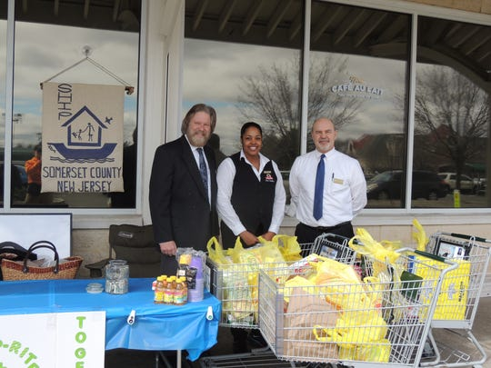 """ShopRite of Branchburg hosted a food drive to benefit SHIP (Samaritan Homeless Interim Program) on April 1. The generosity of the community netted seven shopping baskets filled with canned goods and other items in addition to cash donations of close to $200. Tom O'Leary, CEO of SHIP, extended his thanks to all, saying, """"I am grateful to you all for responding to the needs of the many people who are underserved in our community."""" In addition to providing anti-hunger programs, SHIP, which is a faith-based, interfaith and community funded grassroots organization, offers an array of social services and programs to those in need. For more information visit ship908.com or call 908-393-9545. From left: William Caulfield, Octavia Porter and Mark Sranciotti."""