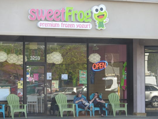 As the weather warms up, Sweet Frog, a frozen yogurt shop on Maple Avenue in Zanesville, is getting busier.