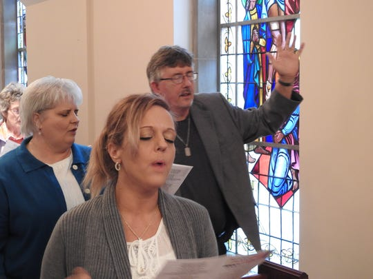 Congregants sang hymns and shared in prayer during Coshocton County's observance of the National Day of Prayer Thursday.