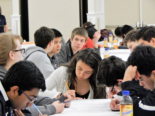 Multiple schools working on grade 10-12 Math League team questions Tuesday, April 25.