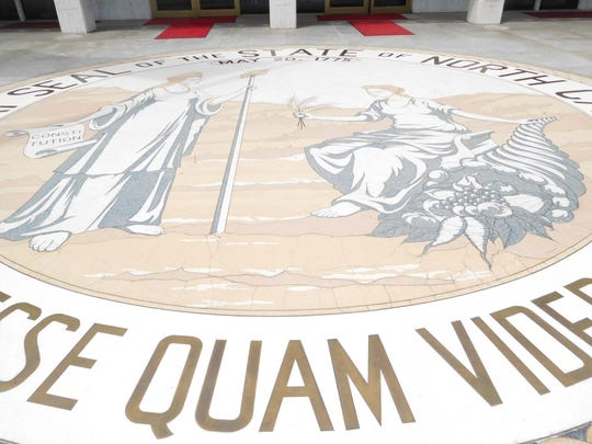 The N.C. state seal is embedded in the floor of the entrance to the Legislative Building. While some politicians claim tax cuts pay for themselves, most economists dismiss that idea, says Robert Tatum, an associate professor of economics at UNC Asheville.