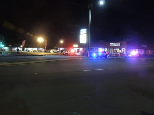 Police investigate a double shooting outside a northeast