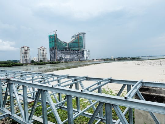 Construction projects line the waterfront of a changing