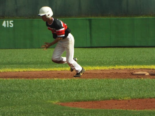 Crusader's Mark Laanan had four hits in the Crusaders 5-4 loss to the Canyons in the Amateur Summer Wood Bat League at LeoPalace Resort.