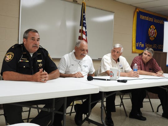 Coshocton County Sheriff Tim Rogers, Fire Chief Mike Layton, Mayor Steve Mercer and City Services Director Max Crown addressed the media at a press conference Wednesday regarding a bomb threat and anthrax scare at Coshocton Municipal Court in Coshocton City Hall.