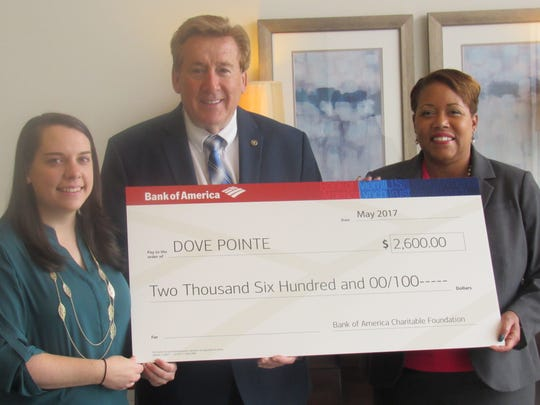 Bank of America Foundation check presentation of $2,600 (left to right) Emily Nielson, director of children's services; Don Hackett, Dove Pointe executive director; Janet Currie, Bank of America Foundation.
