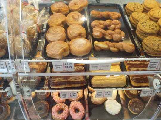 A well-stocked case of fresh baked doughnuts is hard