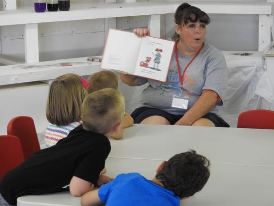 Angie Moses reads a story to students of Safety City at the Coshocton County Fairgrounds.