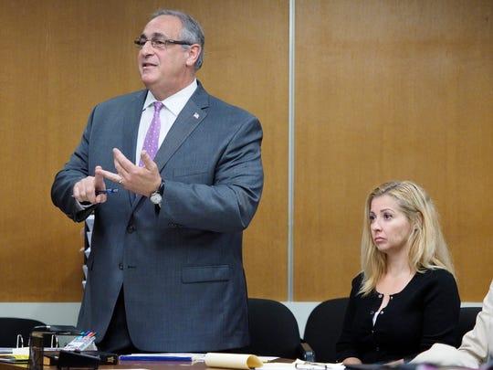 Alycia Dotro listens as her attorney, Richard Incremona, addresses the court in New Brunswick.