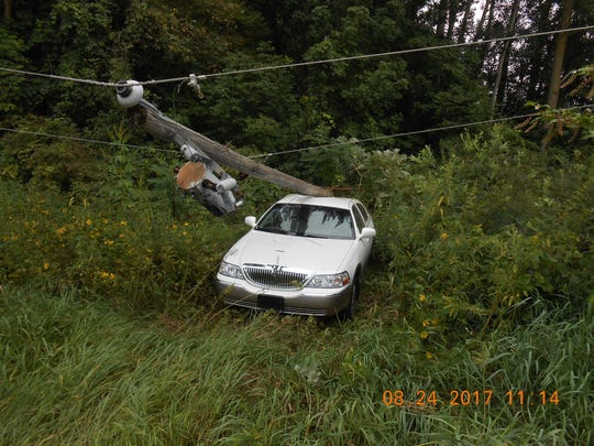 A Tekonsha woman was not hurt after he car hit a power