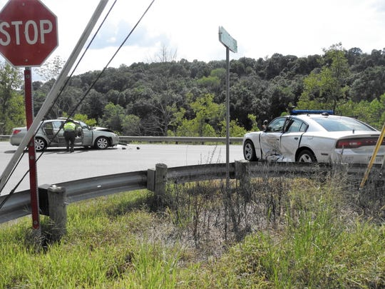 A State Highway Patrolman was involved in a crash sent a woman and the trooper to the hospital Friday afternoon.
