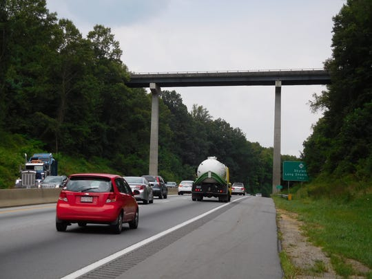Cars and trucks stream under the Blue Ridge Parkway