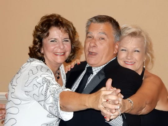 Marllyn Justice, Dale Justice and Sue Dempsey practice their moves for the upcoming Black & White Masquerade Ball sponsored by the Exchange Club of Indian River Foundation.