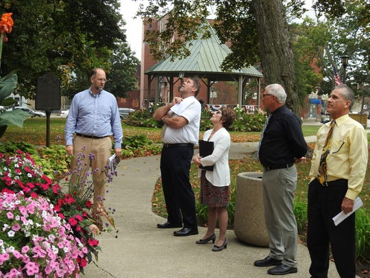 Dan Boggas of Cross Light dicusses a courthouse lighting project with Commissioner D. Curtis Lee, Barb Karr of Our Town Coshocton and Commissioners Dane Shryock and Gary Fischer.