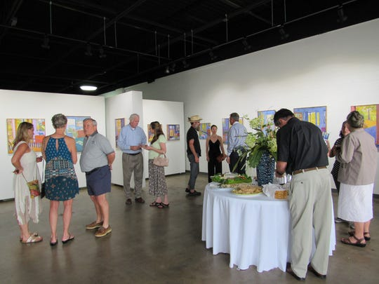 Community members celebrate the grand opening of the Gamut Gallery this summer.