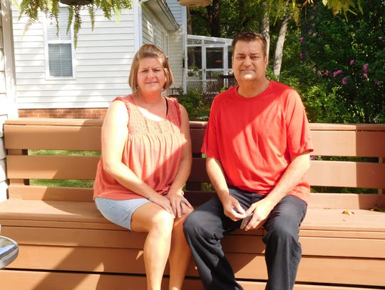 Karen Bailey and William Bradley sit outside the Simpsonville