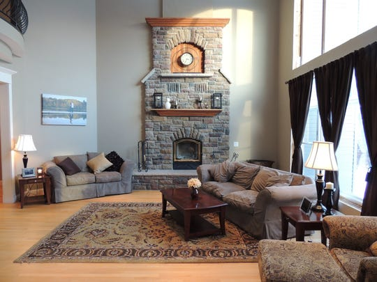 Enjoy natural light and a stone fireplace in the spacious
