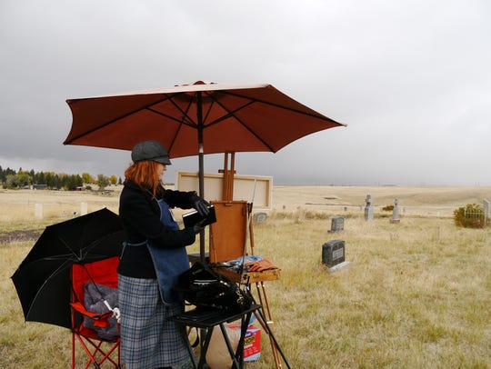 Jane Cushman sets up her work at the old Highland Calvary